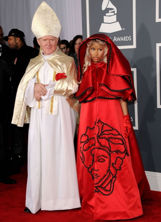 Nicki Minaj on the red carper at the 54th Grammys...with a Pope lookalike
