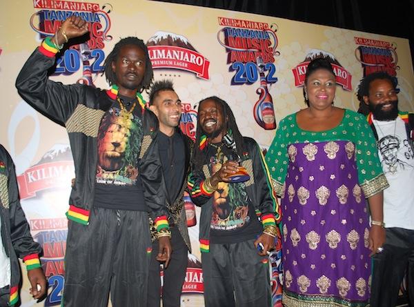 Warriors from the East posing with Ally Rehmtullah and Khadija Mwanamboka