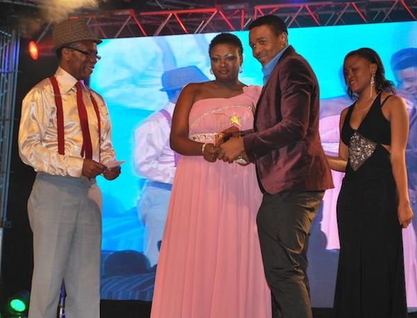 Dina Marios presenting the award to Ali Kiba