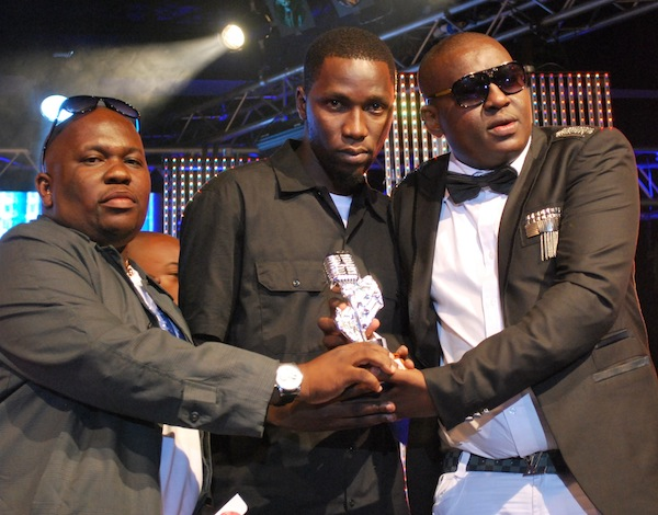 Professor Jay and Mkubwa Fella present the award to ROMA