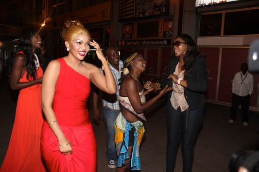 Omotola being asked to dance by a traditional 'ngoma' dancer