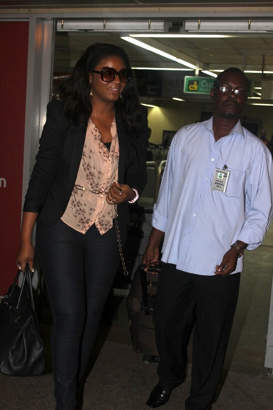 Omotola and Peter at JNIA's arrivals