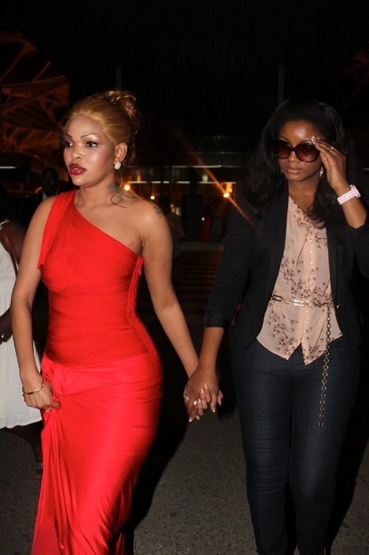 Wema escorting her guest Omotola to the car
