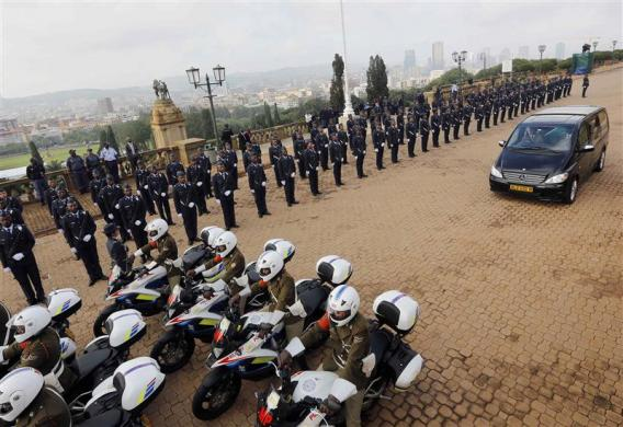Cortege carrying the coffin of former South African President Nelson Mandela arrives at the Union Buildings, marking the start of a three-day lying-in state, in Pretoria