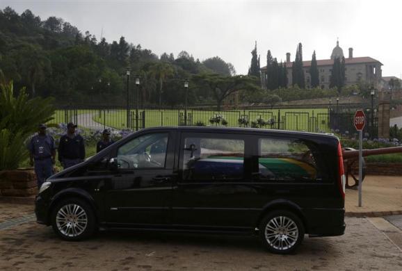 The funeral cortege carrying the coffin of former South African President Mandela arrives at the Union Buildings in Pretoria