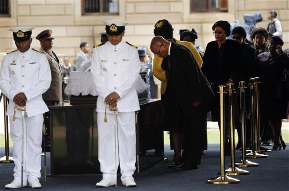 South African President Jacob Zuma pays his respects at the coffin of former South African President Nelson Mandela, lying in state at the Union Buildings in Pretoria