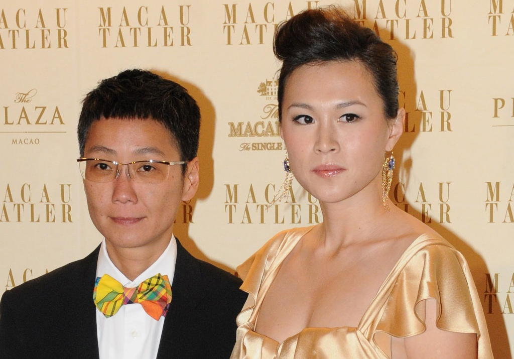 "HONG KONG OUT - TAIWAN OUTThis picture taken in Macau on September 4, 2011 shows Gigi Chao (R), the daughter of Hong Kong tycoon Cecil Chao Sze-tsung with her partner.  According local September 26, 2012 reports, Cecil Chao announced a ""marriage bounty"" of 500 million HKD (65 million USD) to any man who can win the heart of his lesbian daughter after she married her same-sex partner of seven years in France earlier in 2012.       HONG KONG OUT - TAIWAN OUT -    AFP PHOTO/Apple Daily     ----EDITORS NOTE -- RESTRICTED TO EDITORIAL USE - MANDATORY CREDIT ""AFP PHOTO/Apple Daily"" - NO MARKETING NO ADVERTISING CAMPAIGNS - DISTRIBUTED AS A SERVICE TO CLIENTS - NO ARCHIVES"