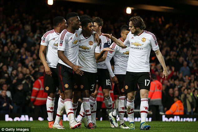 3325F1F700000578-3538663-Rashford_is_mobbed_by_his_Manchester_United_team_mates_after_bre-a-2_1460584246732