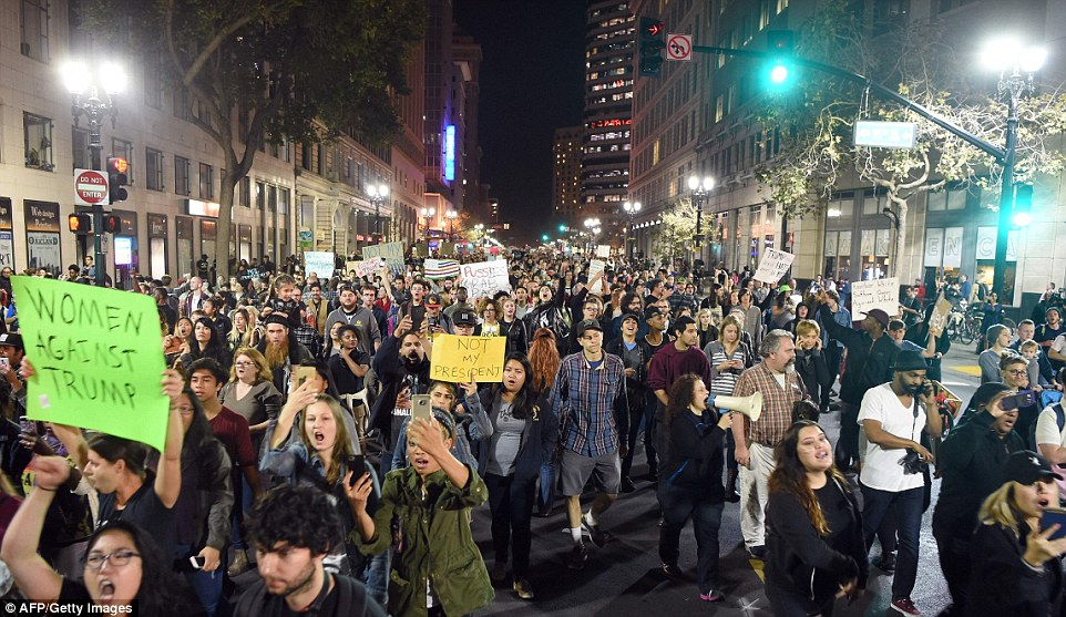 3a3925f600000578-3923346-people_march_and_shout_during_an_anti_trump_protest_in_oakland_c-a-18_1478798612240